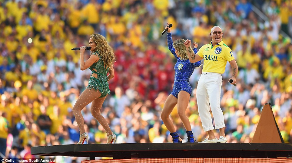 In the mood: J-LO, Leitte and Pitbull perform on the central stage in Sao Paulo ahead of the World Cup opener between Brazil and Croatia