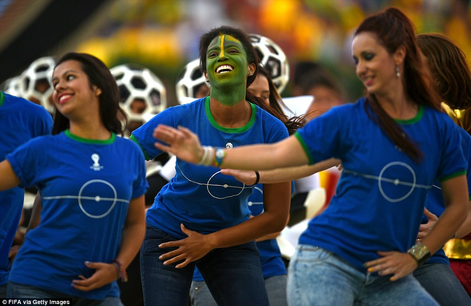 Performers dance during the 2014 FIFA World Cup Brazil Opening Ceremony at Arena de Sao Paulo on June 12