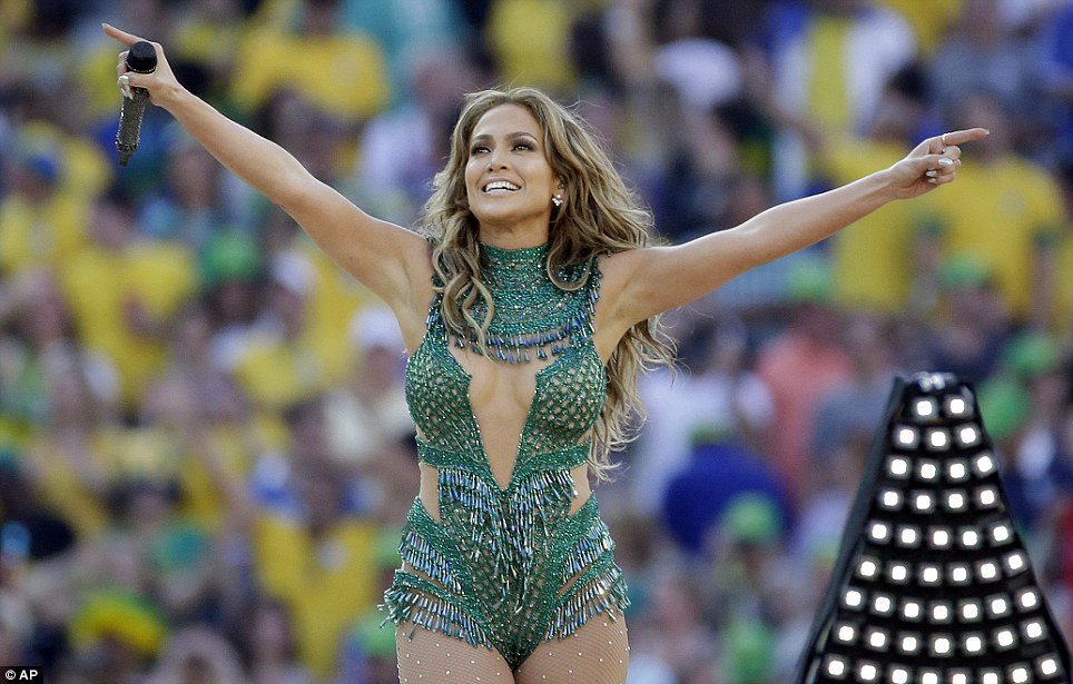 Start: J-LO acknowledges the crowd after singing the official World Cup song 'We Are One (Ola Ola)' alongside Pitbull