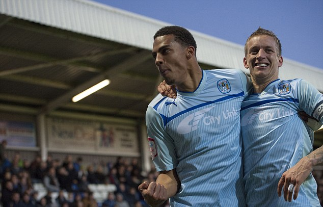 Target: Callum Wilson (left) celebrates scoring for Coventry but may be playing for Bournemouth next year
