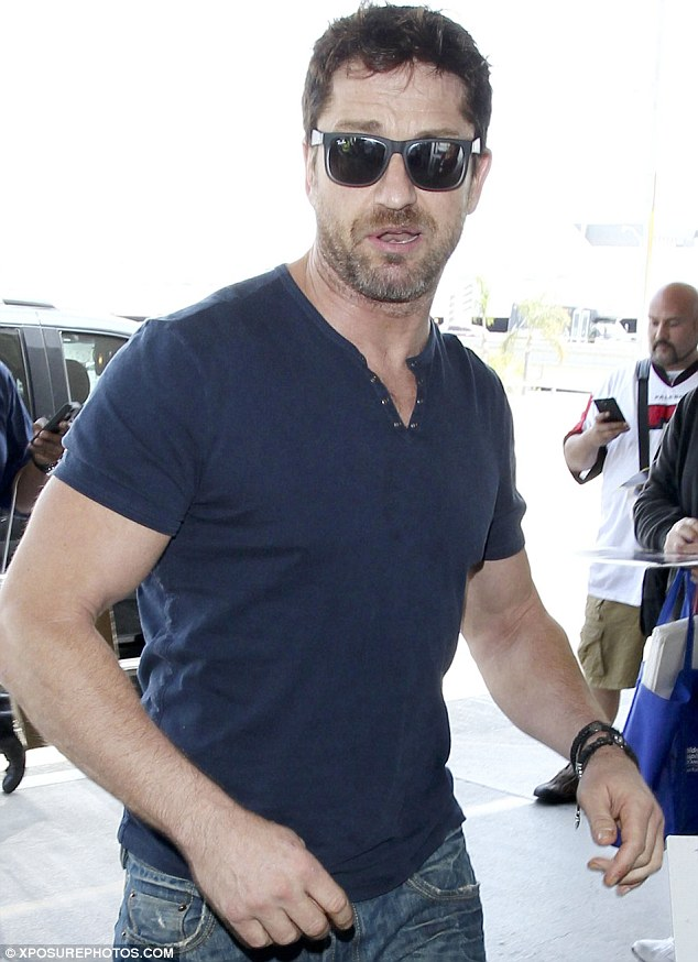 Hunk: The notorious ladies man looked as good as ever as he got ready to catch a flight in Los Angeles