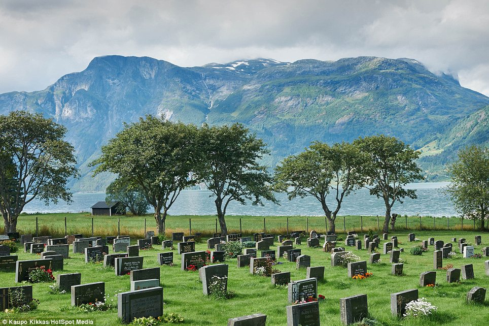 Shadow of a mountain: A graveyard in Jostedalsbreen, Norway. Kikkas has travelled the globe and captured some of the world's weirdest and most wonderful burial grounds