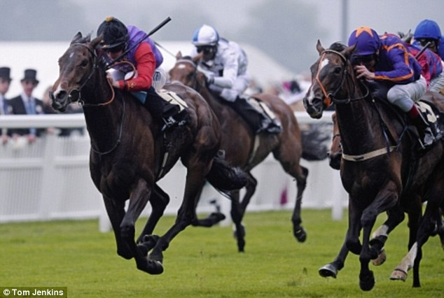 The Queen's horse Estimate ridden by Ryan Moore (left) winning the Gold Cup