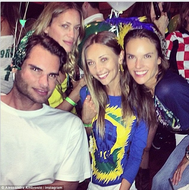 Team spirit: She Instagrammed this photo on Thursday, writing, 'Vai Brasil !!! paixão nacional e internacional #copadomundo #2014fifaworldcup'