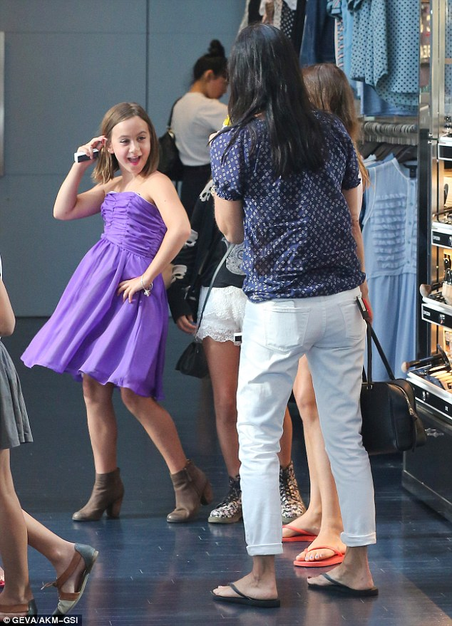 She likes this one: Coco gave a purple dress a twirl as she practiced some dance moves for her mom