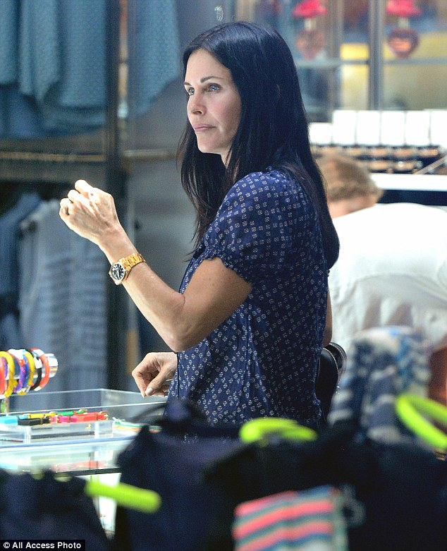 Got the time: The Cougar Town star sported a chic watch as she stood in front of the timepiece counter