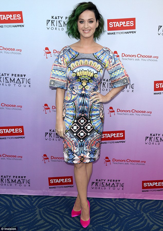 California girl: Katy Perry arrived at the Nokia theater in downtown Los Angeles rocking her always-changing locks and a colorful geometric-print frock for the announcement of her new philanthropic event