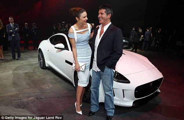 Celebrities: Model Miranda Kerr and Simon Cowell celebrating the debut of the 2015 Jaguar F-TYPE R Coupe