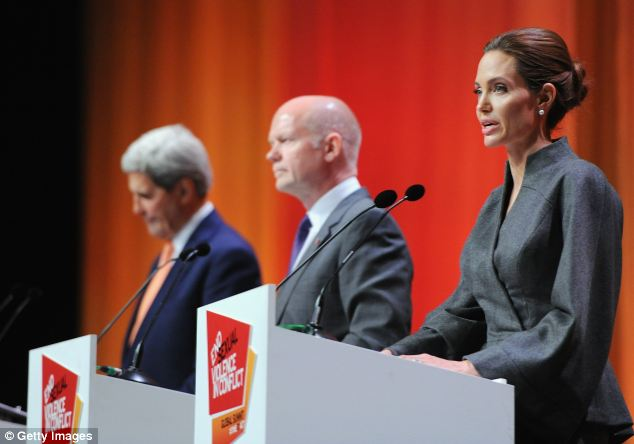 Campaign: US Secretary of State John Kerry, William Hague and actress Angelina Jolie speak to crowds during the fourth day of the London conference. Hague said he had discussed the Iraq conflict with Mr Kerry