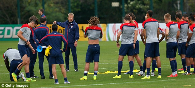 Talking tactics: Jurgen Klinsmann gets his point across to his players during training earlier this week