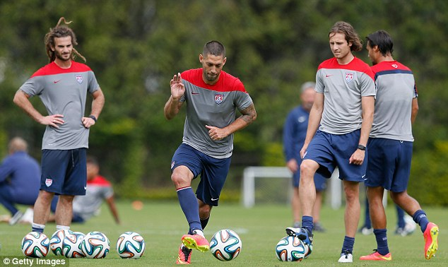 Incentive: USA players, including Clint Dempsey (centre) could earn a fortune if they win the World Cup
