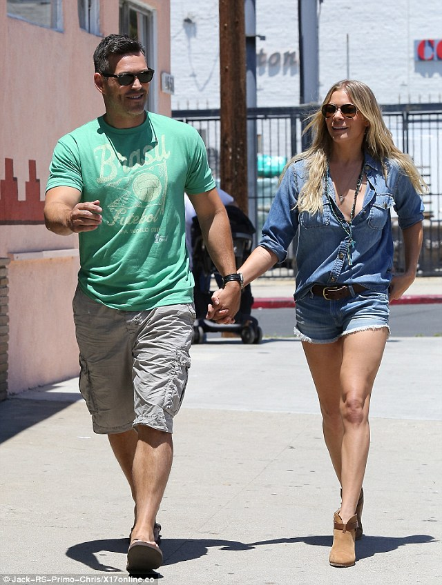 Cute couple: Eddie, 40 and LeAnn, 31 enjoy a walk together in the LA sunshine. The pair were lucky they didn't have an awkward meeting with reality star Brandi, 41