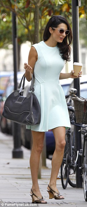 Slender frame: The human rights lawyer looked seriously stylish in an ice blue skater dress as she puts her slim legs on display