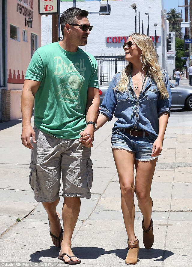 Look of love: The couple gazed at each other clasping hands. They have had a difficult relationship with Brandi since news of their affair broke in 2009. Brandi is mother to Eddie's two sons Mason and Jake.