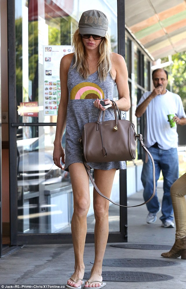 All LOVE: Brandi wore a cap emblazoned with LOVE and donned a casual tank-top dress