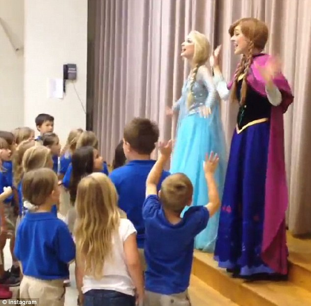 The good queen: Carlson has been making appearances at schools and hospitals, bringing joy to little fans of the Disney film