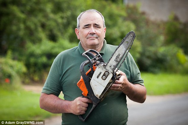Accident: Larry Smith sliced his arm to the bone with a chainsaw and was turned away from two doctors practices in Fairford, Gloucestershire