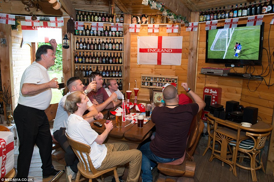 Shedloads of fun: John Plumridge, 59, and his son John, 26, will watch from the comfort of their shed in Shrewsbury after they spent £10,000 turning it into a sports bar