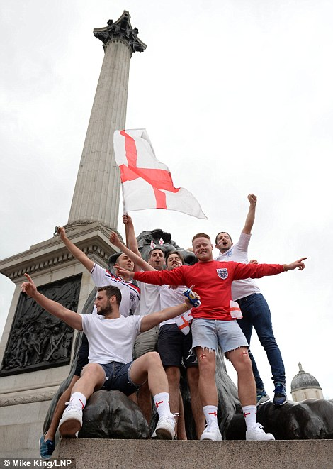 Towering hopes: Football fans gathered in Trafalgar Square in central London, where authorities have laid on hundreds of extra night buses to get revellers home safely