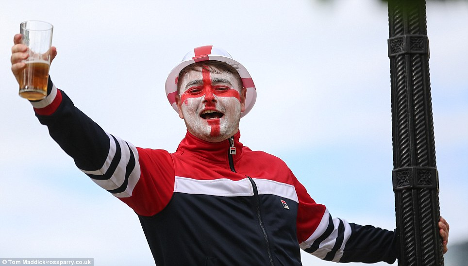 Getting the celebrations started: This fan began partying early in Leeds as police and ambulance services warned there could be an increase in alcohol-fuelled incidents