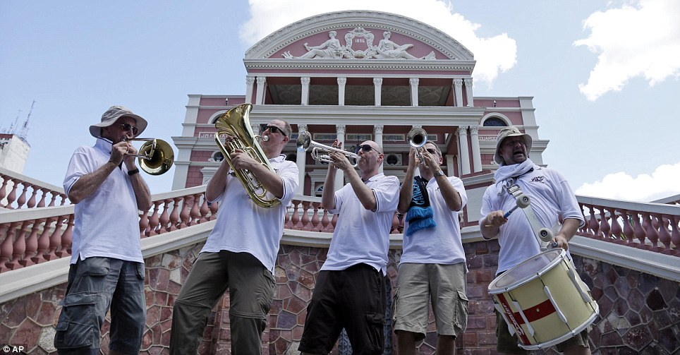 Meanwhile in Brazil: The England Band, from Sheffield, has been a permanent fixture at the tournament since 1998 - and this time was no exception. They warmed up tonight in Manaus (pictured) - but have been told they will not be able to take their now-famous collection of brass instruments and a drum into the stadium itself