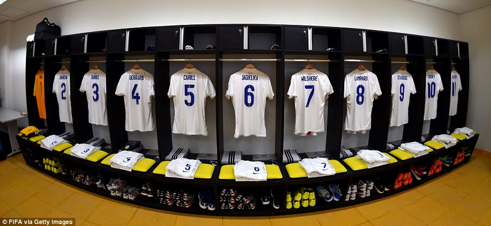 Three lions on a shirt: The England kit hangs ready in the dressing rooms of the Arena da Amazonia - hours before being worn by Gerrard, Lampard, Wilshere et al