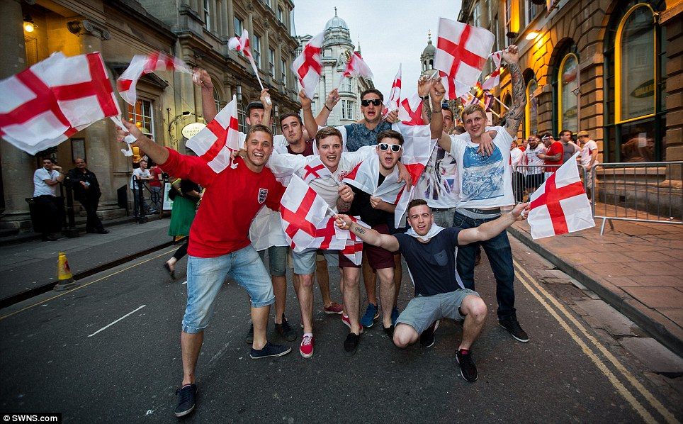 Meanwhile, in England: Fans took advantage of the 11pm kick-off to fill the day with drinking and merriment - and this group in the streets of Bristol were no exception