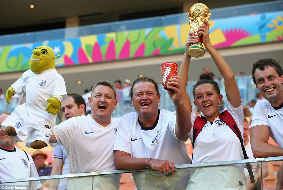Optimistic: England fans also had high hopes of victory as they held an imitation World Cup trophy aloft - and even cartoon ogre Shrek joined in the festivities