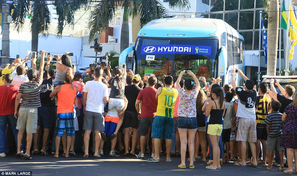 Buffeted: The team's bus was surrounded by football fans from all nations as it made its way from the hotel in Manaus to the Arena da Amazonia