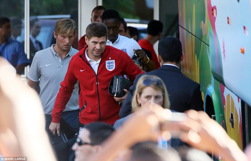 On their way: Steven Gerrard led the way as the team was mobbed by fans emerging from their hotel in Manaus to make the short journey to the stadium