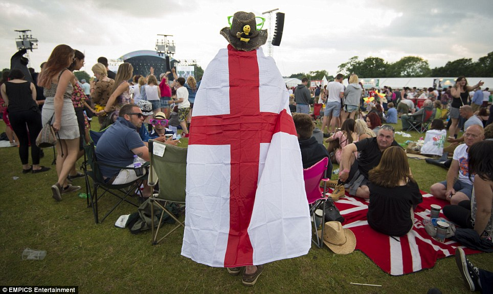 Tough choices: At the Isle of Wight Festival, fans were facing the option of watching the match with the rest of the country or seeing the Red Hot Chili Peppers