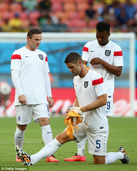 Warm-up: The England team came out to prepare for the game in gleaming white and red before a packed Arena da Amazonia in Manaus