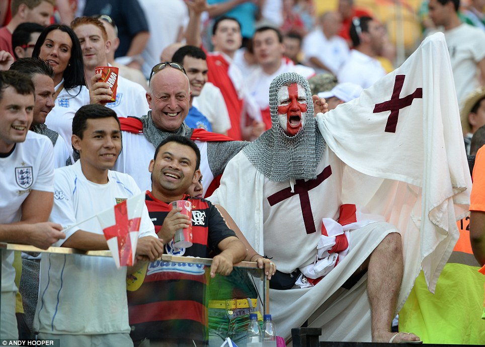 Ready for kick-off! Fans gathered in full costume in the Arena da Amazonia in Manaus, Brazil, for England's World Cup clash against Italy in the Amazon rainforest