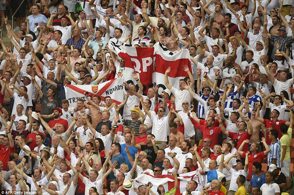 Roar of the lions! The stadium in Brazil turned red for the singing of the national anthem, with thousands of England fans dressed for the occasion in St George's crosses
