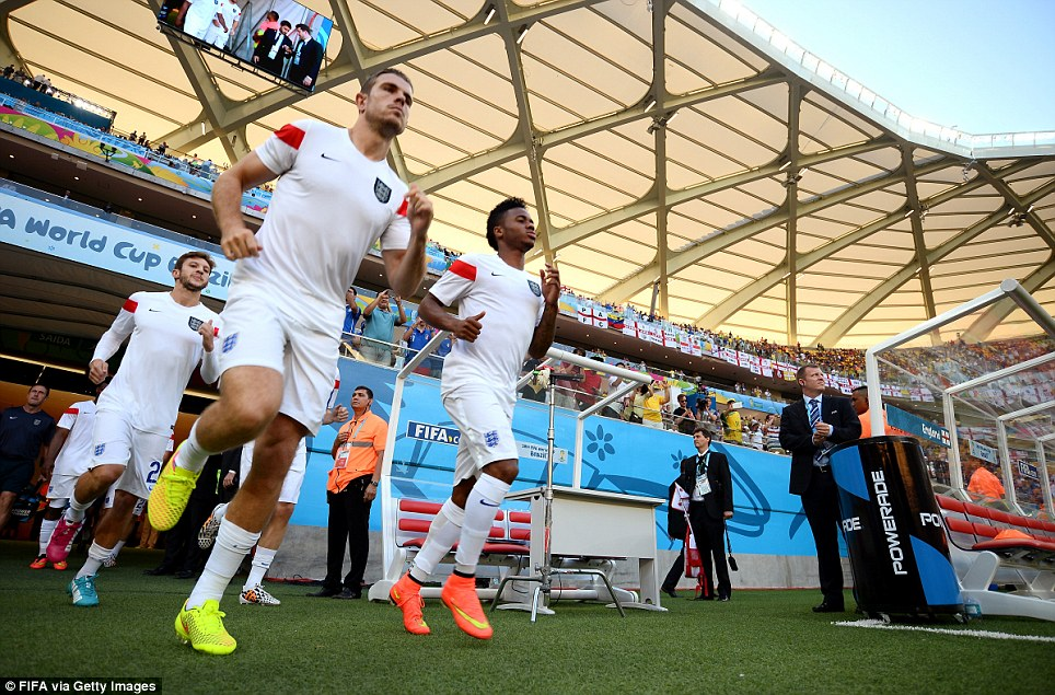 Pride of Lions: Raheem Sterling of England leads the team out prior to the start of the first England World Cup match at the Arena da Amazonia in Manaus