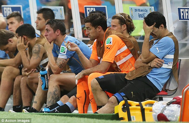 Distraught: Luis Suarez can't watch as his Uruguay falter at their first World Cup hurdle against Costa Rica