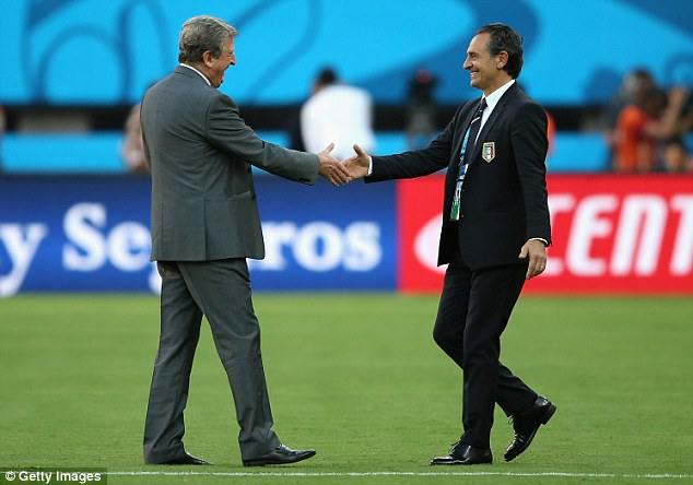 Old friends: Roy Hodgson meets his Italian counterpart Cesare Prandelli in the middle of the pitch prior to kick-off