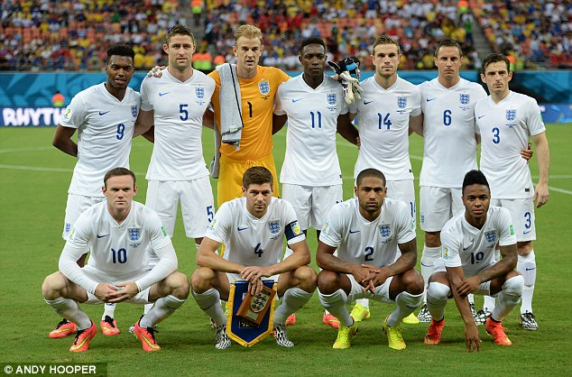 Ready to roar: England line up for the customary pre-match photograph as they begin their World Cup campaign