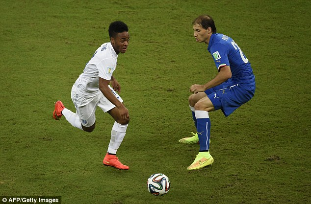 Burned: Raheem Sterling manoeuvres the ball past Italian defender Gabriel Paletta during the opening few moments of the match