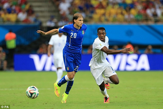 Eyes on the ball: Danny Welbeck goes the long way round Gabriel Paletta in pursuit of the ball