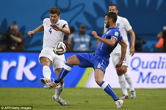 Midfield battle: Italy's Antonio Candreva tries to intercept a Steven Gerrard long pass