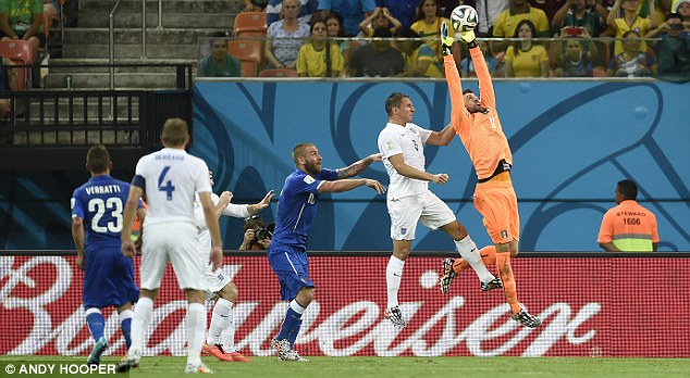 At a stretch: Sirigu takes the ball in the air with Phil Jagielka in close proximity