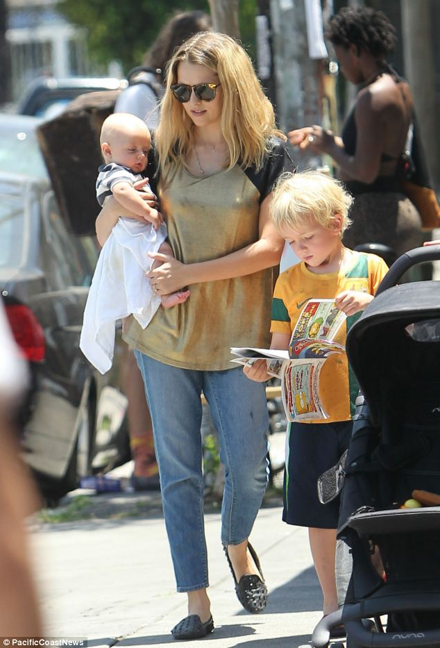Looking good: Teresa, who gave birth to Bohdi in February, showed off her post-pregnancy figure in a pair of loose-fitting jeans, a baggy gold T-shirt with leather sleeves and studded flats