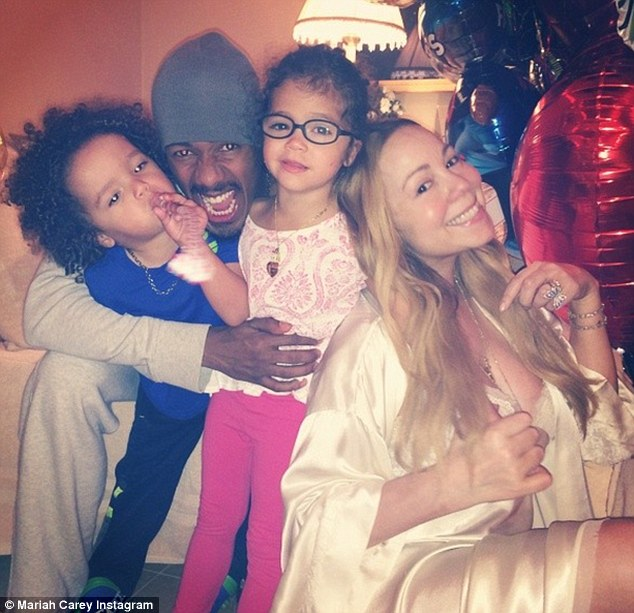 No issues here: Mariah killed rumors of marital problems by posting thios touching photograph of herself with her husband of six years Nick Cannon and their two children