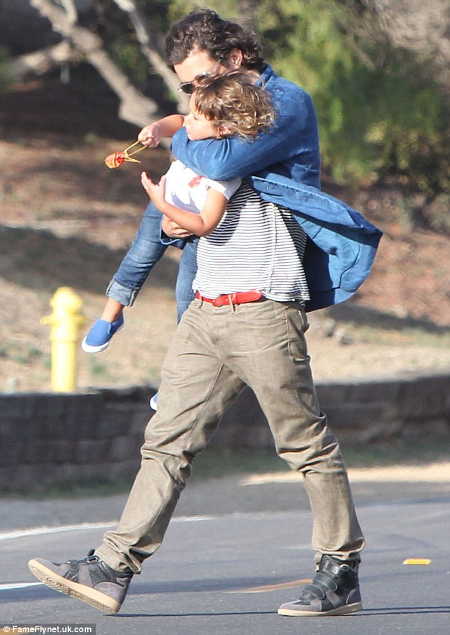 Hold on tight: The 37-year-old pulls three-year-old Flynn in close for a kiss