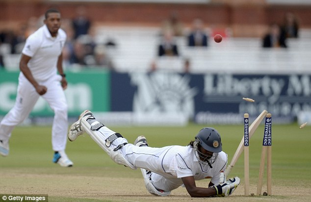 Crash: Nuwan Pradeep hits his wicket avoiding a short ball from Chris Jordan