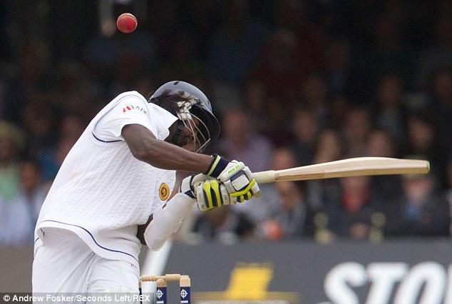 Hitting the target: Nuwan Pradeep felt the full force of Chris Jordan's delivery