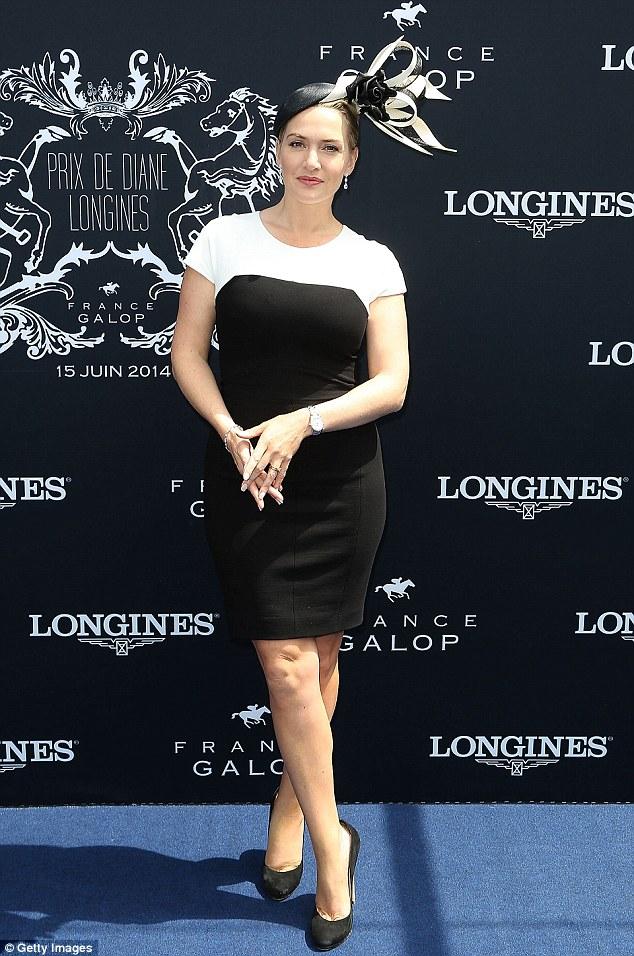 English Rose: Kate Winslet wears a monochrome floral headpiece to the Prix de Diane Longines 2014