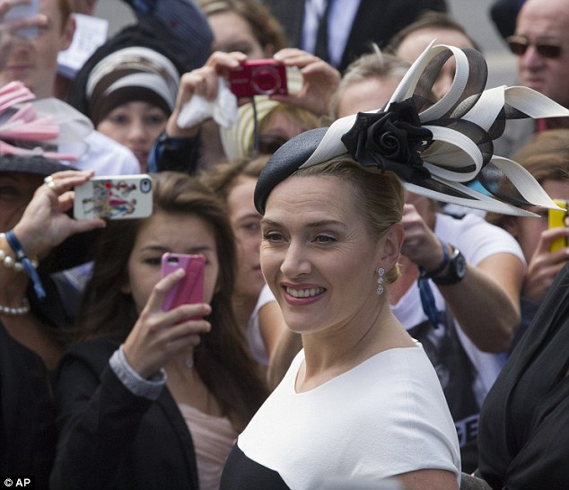 Centre of attention: Everyone wanted to get a photo of the Oscar-winning actress