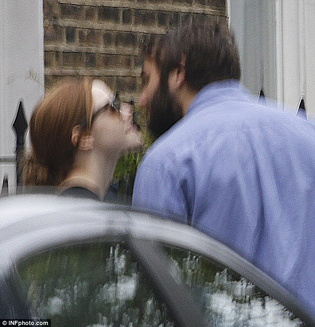 Lip service: The couple of six months were caught sharing a kiss as they made their way to Regents Park eatery The Place